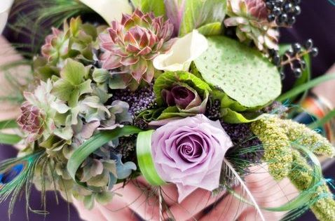 succulents, peacock feathers and lavendar roses