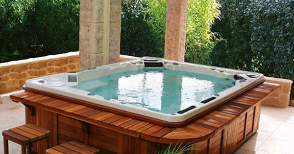Amazing jacuzzi Love the seating area around the jacuzzi The Yard Pinterest Jacuzzi Bar and Hot tubs