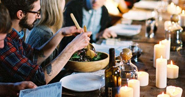 a wooden table, food, friends, and candles for days via Kinfolk Magazine