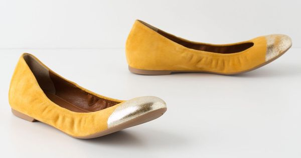 yellow and metallic flats