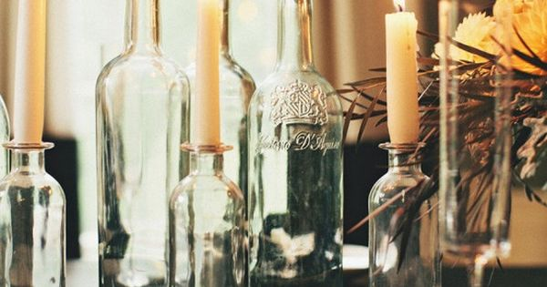 Recycle those empty wine bottles and use them as candle holders! Great