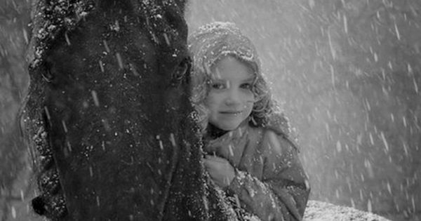"""It's snow wonderful"" Young girl and horse share a moment in the"