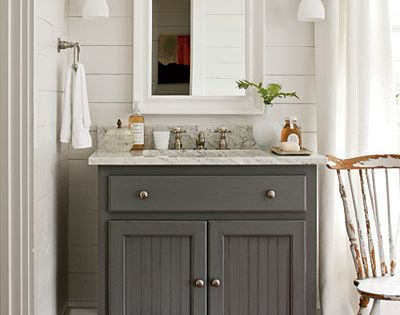 Great bathroom ideas! Wall planks, gray cabinet, marble look top.