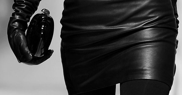 black leather skirt and black leather gloves