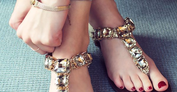 Bling on spring with jewel-toned nails and a pair of Steve Madden Gram sandal. The stylish gold sandals are encrusted in oversized gemstones and feature an adjustable heel strap. | See more about Gold Sandals, Steve Madden and Sandals.