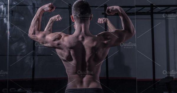 bodybuilder muscular strong gym dark