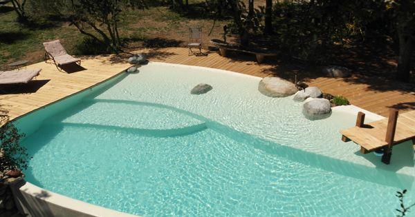 Piscine traditionnelle marinal forme libre finition b ton for Finition piscine beton