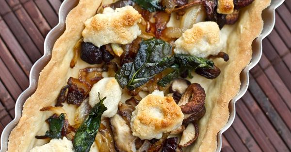 "Mushroom, Onion and Spinach tart with ""goat cheeze."" Looks like some delicious"