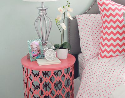 Painted trash can turned over as side table. ((Guest bedroom idea))