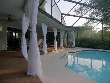Typical Florida Screen Porch Looks Much Better With Some Curtains Outdoorcurtains Patiopanels Patiodrap Outdoor Patio Drapes Lanai Decorating Backyard Pool