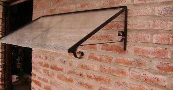 Alero hierro y policarbonato para puertas y ventanas for Tejados madera ourense