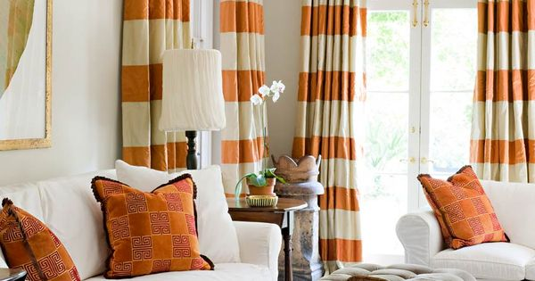 Patterned window treatments. Orange living rooms.