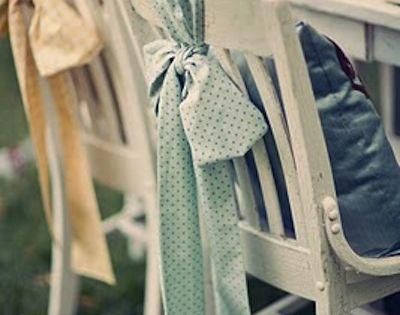 Mismatched floral chair sash, cute idea.