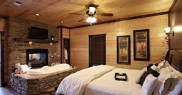 Romantic Bedroom With A King Size Bed Jacuzzi Tub And Fireplace