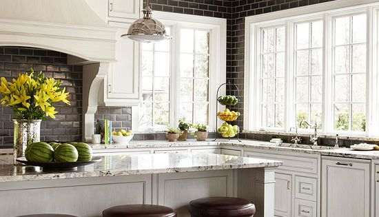 Bright-white cabinets look gorgeous against sleek black subway tile. I would love