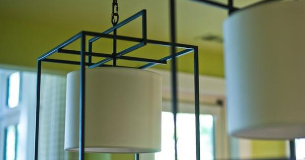 Supporting HGTV Dream Home's design motif of square shapes, iron cage lights