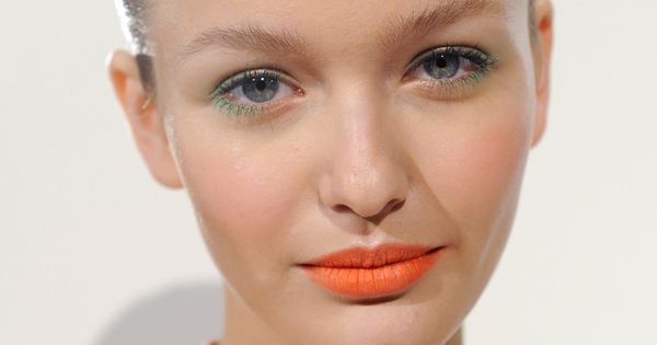 Soft green eyes and matte orange lips at J. Crew Spring 2013
