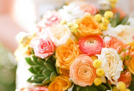 Peach Bouquets. Bouquet of roses and ranunculus in peach, orange, pink, and,