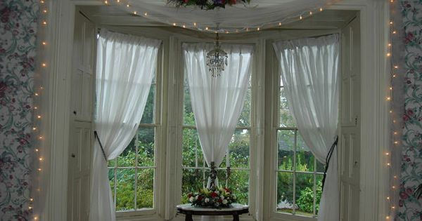 Bay window curtain configuration dining room inspiration for Old world curtains and drapes