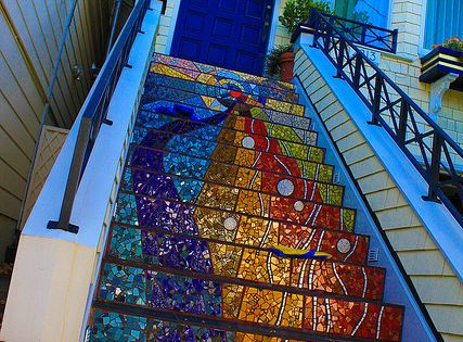 Rainbow mosaic steps with bright blue door
