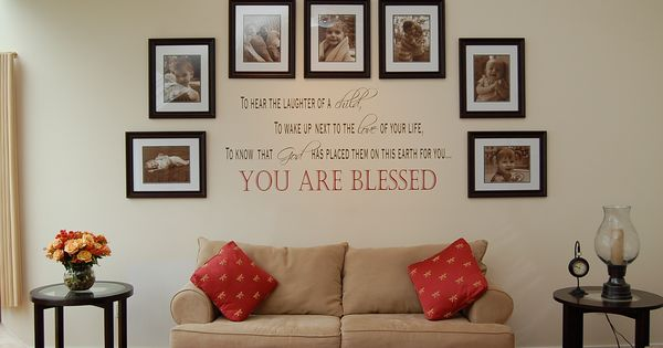 "beautiful arrangement of picture frames and wall quote ""To hear laughter of"