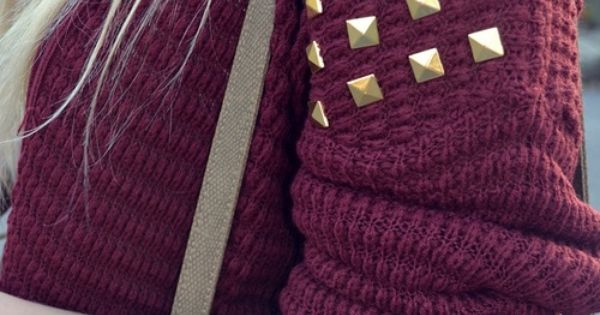 I love the color of the sweater, contrasted with gold studs.