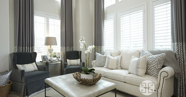 A sleek and sophisticated living room decor by a well for Sleek living room designs