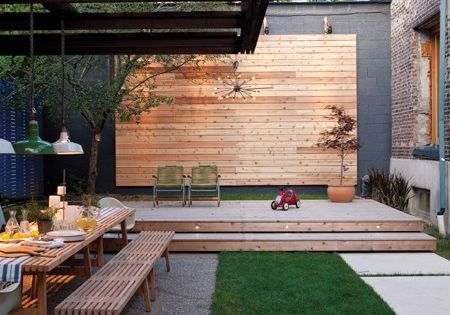 A raised platform becomes a stage for children's performances. Deck Modern Create