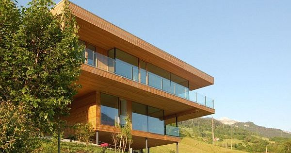 Two Story Contemporary Home Made Out From Concrete Wood And Gl