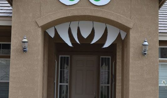 Decorate front entry way as a monster for Halloween