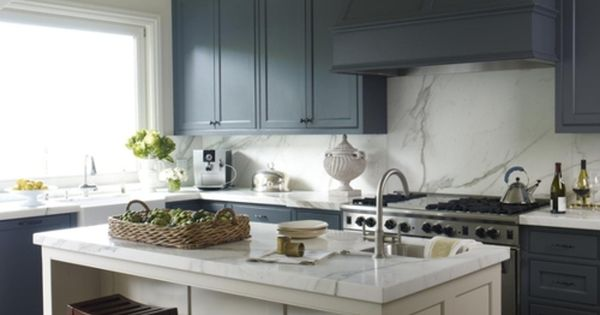 Kitchen With Blue Island And White Cabinets