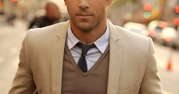 Ryan Reynolds showing us a early spring ensemble of beige sports coat,