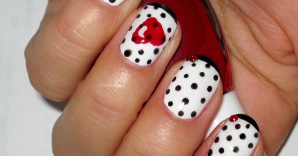 Sweet Love black polka dot nail design.