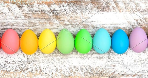 Colorful Easter eggs decoration on wooden background. Holidays banner