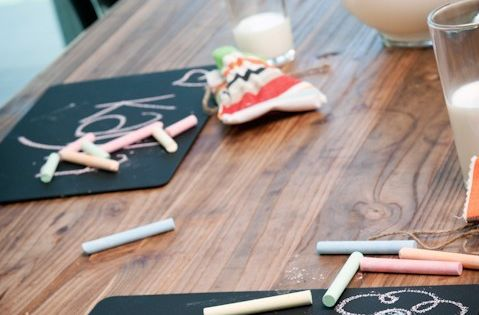 Dollar Store placemats spray painted with chalkboard paint. Student chalk boards for