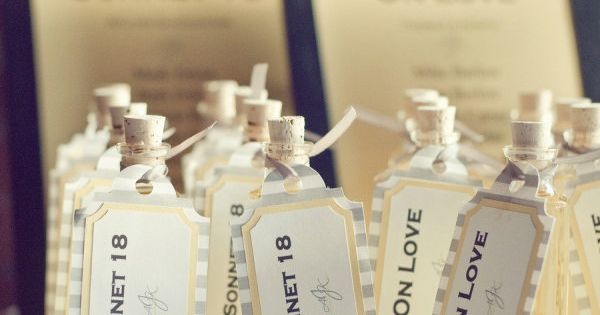 homemade Limoncello favors with seating assignments. The tables were named after the