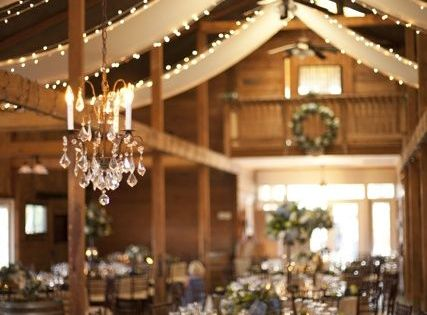 A simple chandelier and lights added to the sides of ceiling burlap