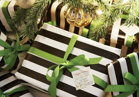 Modern Gift Wrapping: black and white stripes paper and green ribbon.
