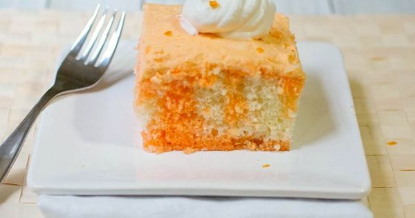 Perfect dessert for summer - Orange Cream Poke Cake!