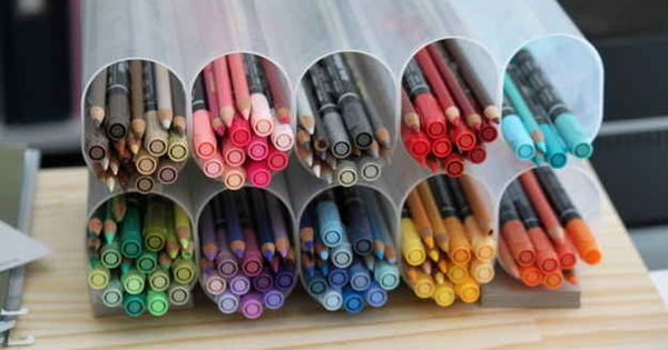 Separate colored pencils, markers or crayons by color by taping together old