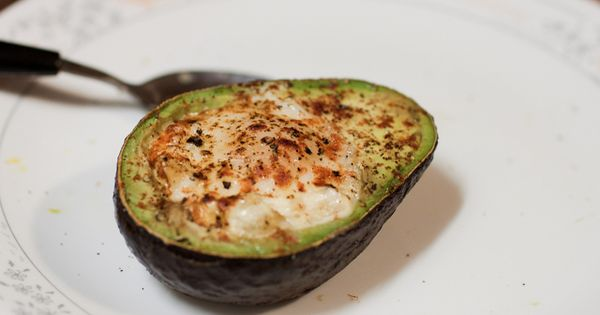 Baked avocado and egg. Healthy breakfast treat