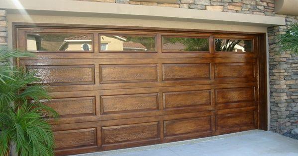 faux wood paint on metal garage door. Great idea instead of real