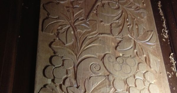 Woodcarving low relief on mahogany doors