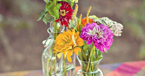 wedding tent ideas photos - Wildflower Centerpieces bright colors love this