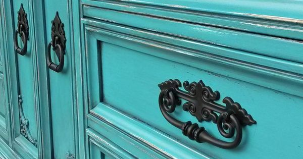 distressed turquoise dresser with ornate black pulls turquoise