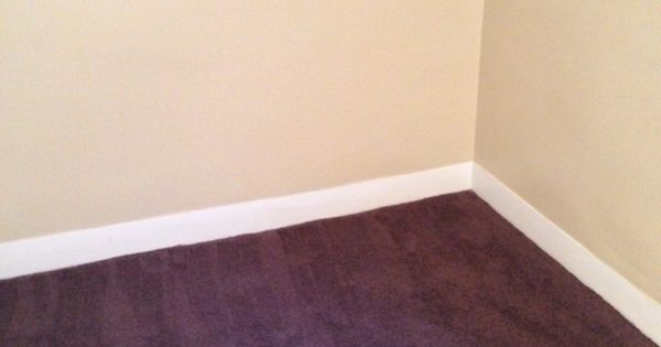 Light Tan Walls With White Trim And Dark Burgundy Carpet