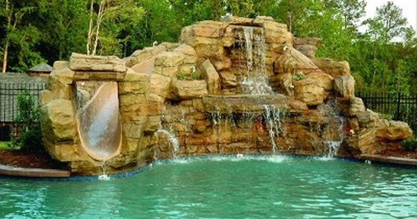 exquisite pool with rock waterfall and slide