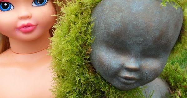 Creepy garden idea-Use old doll head as a cement mold.