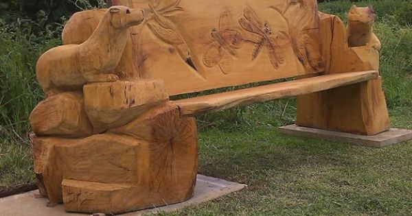 Chainsaw carved otter and climbing frog oak bench