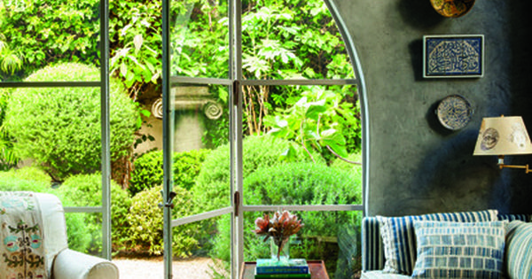 What a wonderful living room with arched glass door to the garden.